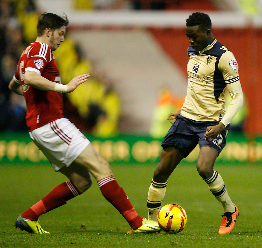 Nottingham Forest's Greg Halford (L) and Leeds United's Gboly Ariyibi in action during todays match  <br /> <br /> Photo by Jack Phillips/CameraSport<br /> <br /> Football - The Football League Sky Bet Championship - Nottingham Forest v Leeds United - Sunday 29th December 2013 - The City Ground - Nottingham<br /> <br /> &copy; CameraSport - 43 Linden Ave. Countesthorpe. Leicester. England. LE8 5PG - Tel: +44 (0) 116 277 4147 - admin@camerasport.com - www.camerasport.com