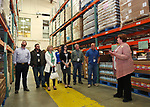 Linda Keenan (R) Director of Development for the Food Bank of Monmouth & Ocean, give a facility tour to Jersey Central Power & Light Employees (L to R) Kieran Tintle, William Kwasnicki, Courtney Donaldson, Elaine Vincent, Melissa Todero, John Mahon & William Puchik after JCP&L presented a check for $6,528.00 to The Food Bank of Monmouth & Ocean Counties in Neptune, NJ on April 13, 2017.