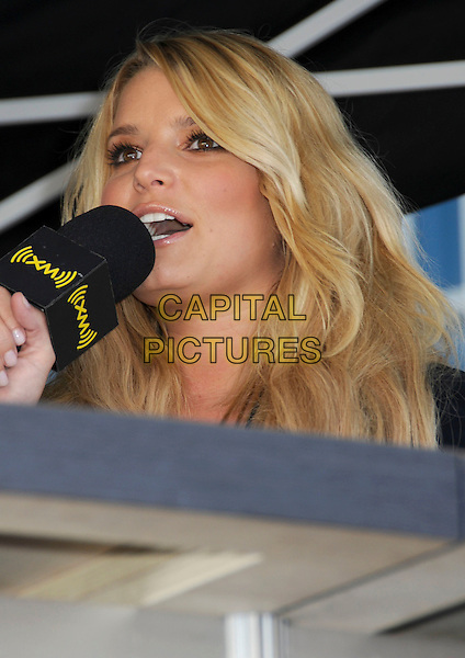 JESSICA SIMPSON.makes a surprise visit at the CMA Music Festival Block Party held at the Chevy Plaza, Nashville, Tennessee, USA, .04 June 2008.portrait headshot microphone speaking.CAP/ADM/LF.© Laura Farr/Admedia/Capital Pictures