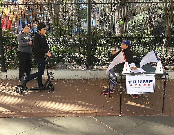 NEW YORK, NY - NOVEMBER 8: A young Trump supporter talks to two teens about the candidate and issues in Tribeca on the afternoon of the U.S. presidential election in New York, New York on November 8, 2016.  Photo Credit: Rainmaker Photo/MediaPunch