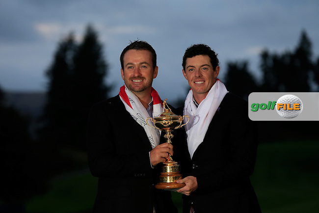 Graeme McDowell and Rory McIlroy (EUR)  after the Sunday singles matches winning the Ryder Cup for Europe. The 40th Ryder Cup is being played over the PGA Centenary Course at The Gleneagles Hotel, Perthshire from 26th to 28th September 2014.: Picture Fran Caffrey, www.golffile.ie: \28/09/2014\