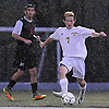 Ryan McMahon #7 of Massapequa moves the ball upfield during the Nassau County Class AA varsity boys soccer playoffs against Syosset at Adelphi University on Sunday, Oct. 30, 2016. Thunder, lightning and heavy rain necessitated a delay nine minutes into the second half a scoreless match.