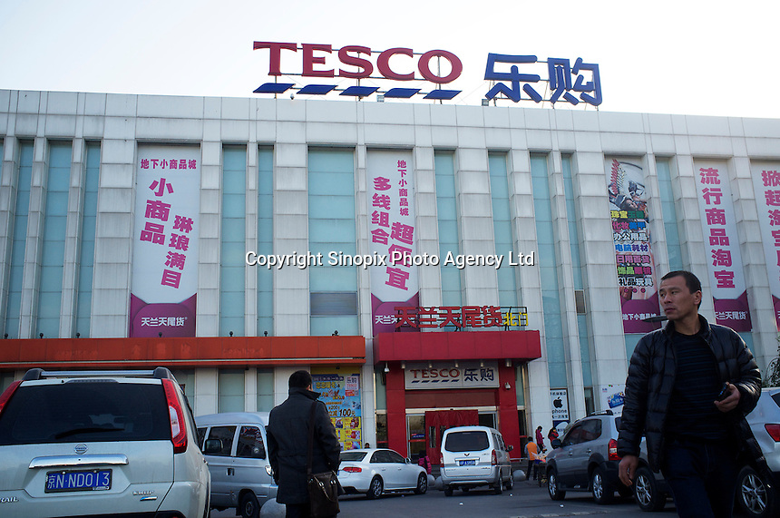 Tesco, in the Fengtai area of Beijing that sells live turtles.  Live turtles are sold and often killed on the premises of the shop.  The turtles cost 48 RMB (4.88 UK pounds) for a kilo. The turtle in the basket cost 163 RMB (16.59 UK pounds).<br /> <br /> Photo by Sinopix