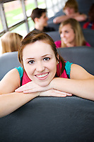 Series with multi-ethnic group of teenage students boarding and on a school bus. Students riding the school bus.
