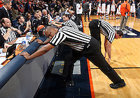 ACC referees stretch before an NCAA basketball game between Virginia and North Carolina Monday Jan. 20, 2014 in Charlottesville, VA. Virginia defeated North Carolina 76-61.