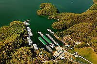 Aerial photography of and around Watauga Lake, Tenn., taken April 2011. Surrounded by the Cherokee National Forest, the vast majority of Watauga Lake's shoreline and surrounding mountains is undeveloped and pristine. Even during busy holiday weekends (photo taken on Easter weekend 2011) the large lake is rarely busy with boaters. Photo shows Fish Springs Marina.