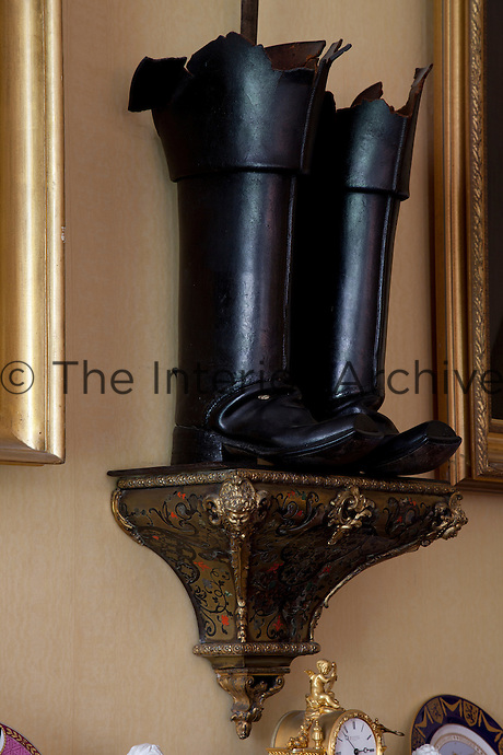 General Tam's Russian boots (perched on a Boulle plinth) above the fireplace in the dining room