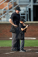 Vincent Stio updates his lineup card as home plate umpire Austin Jones looks on prior to the start of the Carolina League game between the Winston-Salem Dash and the Buies Creek Astros at Jim Perry Stadium on August 15, 2018 in Buies Creek, North Carolina.  The Astros defeated the Dash 5-0.  (Brian Westerholt/Four Seam Images)