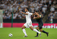 Mousa Dembele of Tottenham Hotspur holds off Radamel Falcao Garcia of Monaco during the UEFA Champions League Group stage match between Tottenham Hotspur and Monaco at White Hart Lane, London, England on 14 September 2016. Photo by Andy Rowland.