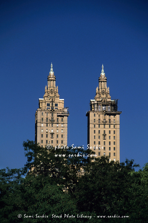 The San Remo twin building seen through the treetops of Central Park, Manhattan, New York, USA.
