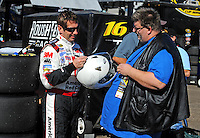 Nov. 7, 2008; Avondale, AZ, USA; NASCAR Sprint Cup Series driver Greg Biffle signs an autograph for a fan during practice for the Checker Auto Parts 500 at Phoenix International Raceway. Mandatory Credit: Mark J. Rebilas-