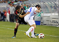 Mexico's Andres Guardado pressures Costa Rica's Jhonny Acosta.  Mexico defeated Costa Rica 4-1 at the 2011 CONCACAF Gold Cup at Soldier Field in Chicago, IL on June 12, 2011.