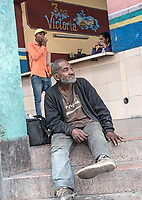 Disabled man and fast food counter, Diez de Octubre, Habana