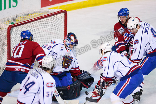 April 28, 2007; Hamilton, ON, CAN; Hamilton Bulldogs goalie (29) Carey Price eyes the puck as Bulldogs and Rochester Americans players close in during game six of the AHL north division semifinal at Copps Coliseum. The Bulldogs won 6-2 and eliminated the Americans from the playoffs. Mandatory Credit: Ron Scheffler, Special to the Spectator. (File number RRSA7670).