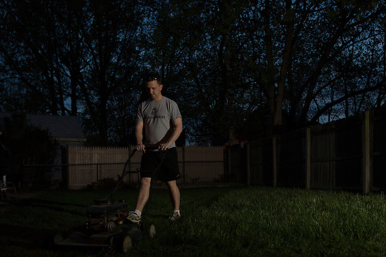 After coaching Benjamin's soccer practice, Matthew mows the lawn in the late evening because it's the only chance he'll have before Benjamin's First Communion party on Saturday.