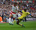 Lawrie Wilson of Stevenage Borough is tackled by Paul Edwards of Barrow  during the  FA Trophy Final between Barrow and Stevenage Borough at Wembley Stadium, London on 8th May,2010..© Kevin Coleman 2010.