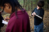 Jasmine Francis, 11, (left) and Manny Babbitt, write notes about nature alongside other sixth grade students from Roger Williams Middle School in Providence, Rhode Island, as they walk along a trail at the Powder Mill Ledges Wildlife Refuge in Smithfield, Rhode Island, on Oct. 20, 2011. The students are part of the EcoExplorer program run by the Providence After School Alliance, which helps to kids in learning environments outside of school time.  <br /> The students make a weekly visit to the refuge, operated by the Rhode Island Audubon Society, to learn about nature and ecology.<br /> <br /> <br /> M. Scott Brauer for Education Week