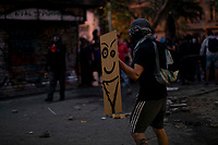 Rioters face police in the streets of dowtown  demanding the resignation of President Sebastian Piñera. Protest erupted in Chile October 18th after a rise in the price of transportation