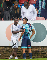 former Watford teammates Bernard Mensah of Aldershot Town & Luke O'Nien of Wycombe Wanderers chat after the match during the pre season friendly match between Aldershot Town and Wycombe Wanderers at the EBB Stadium, Aldershot, England on 22 July 2017. Photo by Andy Rowland.