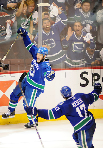 18.05.2011 Vancouver Canucks defender Kevin Bieksa (3) celebrates his second period goal with teammate Ryan Kesler (17) during game 2 of the Western Conference Finals against the San Jose Sharks in Vancouver, British Columbia on Wednesday night.