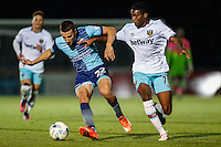 Nick Freeman of Wycombe Wanderers and Olatunji Akinola of West Ham United U21s during the The Checkatrade Trophy match between Wycombe Wanderers and West Ham United U21 at Adams Park, High Wycombe, England on 4 October 2016. Photo by David Horn.
