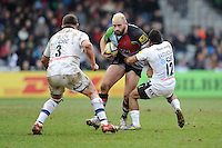 Joe Marler of Harlequins is tackled by Kyle Eastmond (right) and David Wilson of Bath Rugby during the Aviva Premiership match between Harlequins and Bath Rugby at the Twickenham Stoop on Saturday 13th April 2013 (Photo by Rob Munro)