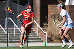 27 February 2016: Maryland's Taylor Cummings (21) and North Carolina's Kelly Devlin (right). The University of North Carolina Tar Heels hosted the University of Maryland Terrapins in a 2016 NCAA Division I Women's Lacrosse match. Maryland won the game 8-7.