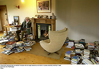 Writer John Moriarty with his selection of books from his large collection at his home in Coolies, Muckross, Killarney in 2006.<br /> Picture by Don MacMonagle
