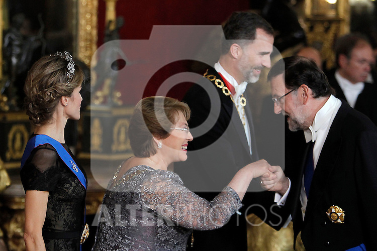 Spanish Royals attend a Gala Dinner in honour of President of Chile Michelle Bachelet at The Royal Palace in Madrid. In the pic Michelle Bachelet speaks with Mariano Rajoy. October 29, 2014. (Jose Luis Cuesta/POOL/ALTERPHOTOS)