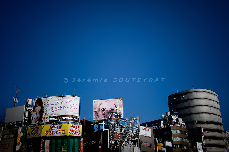 Tokyo, December 11 2011 - Commercial on the top of a building in the Shinjuku area.