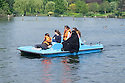A group of Muslim girls enjoying the warm weather over the Bank Holiday weekend, on a pedalo ride in Regent's Park.