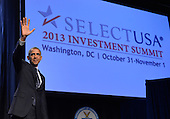 United States President Barack Obama waves as he departs after making remarks to the SelectUSA Investment Summit, after introducing a comprehensive effort by the federal government to bring jobs and investment from around the world to the US, October 31, 2013, in Washington, DC. Obama touted America's productivity, low-cost energy and legal protections as incentives to invest in the US.    <br /> Credit: Mike Theiler / Pool via CNP