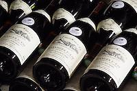 pile of bottles maranges 1er cru clos de la boutiere 2002 dom e monnot & f santenay cote de beaune burgundy france