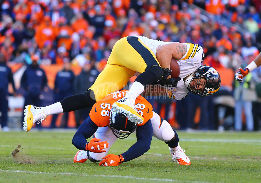 Jan 17, 2016; Denver, CO, USA; Pittsburgh Steelers tight end Matt Spaeth (89) is upended as Denver Broncos linebacker Von Miller (58) tackles him during the AFC Divisional round playoff game at Sports Authority Field at Mile High. Mandatory Credit: Mark J. Rebilas-USA TODAY Sports