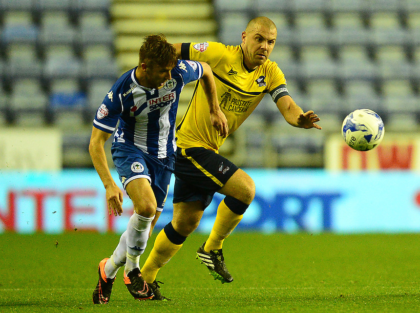 Scunthorpe United's Stephen Dawson vies for possession with Wigan Athletic's Michael Jacobs<br /> <br /> Photographer Richard Martin-Roberts/CameraSport<br /> <br /> Football - The Football League Sky Bet League One - Wigan Athletic v Scunthorpe United - Wednesday 19th August 2015 - DW Stadium - Wigan  <br /> <br /> &copy; CameraSport - 43 Linden Ave. Countesthorpe. Leicester. England. LE8 5PG - Tel: +44 (0) 116 277 4147 - admin@camerasport.com - www.camerasport.com