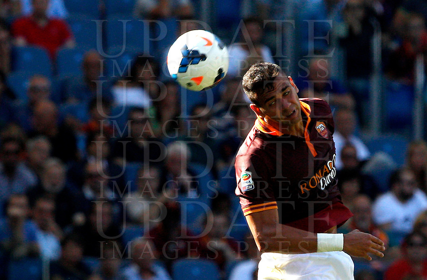 Calcio, Serie A: Roma vs Lazio. Roma, stadio Olimpico, 22 settembre 2013.<br /> AS Roma defender Leandro Castan, of Brazil, heads the ball during the Italian Serie A football match between AS Roma and Lazio, at Rome's Olympic stadium, 22 September 2013.<br /> UPDATE IMAGES PRESS/Riccardo De Luca
