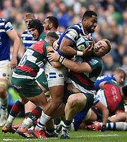Joe Cokanasiga of Bath Rugby is double-tackled by George Ford and Joe Heyes of Leicester Tigers. Gallagher Premiership match, between Leicester Tigers and Bath Rugby on May 18, 2019 at Welford Road in Leicester, England. Photo by: Patrick Khachfe / Onside Images