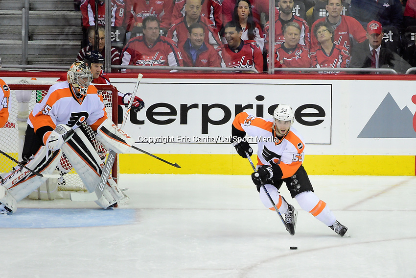 Thursday, April 14, 2016: Philadelphia Flyers defenseman Shayne Gostisbehere (53) works to get the puck out of his defensive zone during game 1 of the first round of the National Hockey League Eastern Conference playoffs  between the Philadelphia Flyers and the Washington Capitals held at the Verizon Center in Washington, DC. Washington defeats Philadelphia 2-0. Eric Canha/CSM