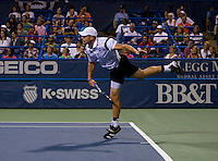 American Andy Roddick follows through on a serve during the Legg Mason Tennis Classic at the William H.G. FitzGerald Tennis Center in Washington, DC.  Giles Simon defeated Andy Roddick in straight sets in a thunderstorm delayed evening session.