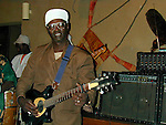 The Malian musician Ali Farka Toure playing in a  tourist hotel  in Tombouctou, Mali - on new years eve 1999/2000.
