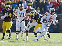 Ohio State Buckeyes quarterback Braxton Miller (5) carries the ball up field against Michigan Wolverines in the 3rd quarter of their college football game at Michigan Stadium in Ann Arbor, Michigan on November 30, 2013.  (Dispatch photo by Kyle Robertson)
