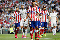 Benzema of Real Madrid and Siqueira, Raul Jimenez Mankukic and Raul Garcia of Atletico de Madrid during La Liga match between Real Madrid and Atletico de Madrid at Santiago Bernabeu stadium in Madrid, Spain. September 13, 2014. (ALTERPHOTOS/Caro Marin)