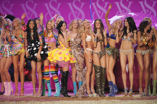 WWW.ACEPIXS.COM . . . . .....November 10 2010, New York City....Victoria's Secret models and Katy Perry (yellow dress) on the runway during the 2010 Victoria's Secret Fashion Show at the Lexington Armory on November 10, 2010 in New York City.  ....Please byline: KRISTIN CALLAHAN - ACEPIXS.COM.. . . . . . ..Ace Pictures, Inc:  ..(212) 243-8787 or (646) 679 0430..e-mail: picturedesk@acepixs.com..web: http://www.acepixs.com