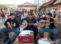 NWA Democrat-Gazette/BEN GOFF @NWABENGOFF<br /> Justin Hall (from left), Chris Schafer and John Stuart of the Holmes Brigade play traditional tunes on Friday Sept. 4, 2015 following a re-enactment of an 1893 bank robbery during First Friday September: Sugar Creek Days on the Bentonville square. The re-enactment was based on the June 5, 1893 robbery in which outlaw Henry Starr and five men made off with cash from the People's Bank of Bentonville after a shootout with civilians and the sheriff.