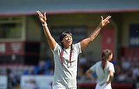 Sandi Bogle (Gogglebox) salutes the supporters during the 'Greatest Show on Turf' Celebrity Event - Once in a Blue Moon Events at the London Borough of Barking and Dagenham Stadium, London, England on 8 May 2016. Photo by Andy Rowland.