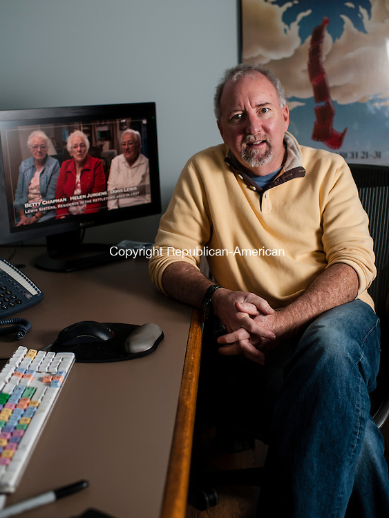 "SOUTHBURY, CT-19 December 2014-121914EC11-  Scott Sniffen sits in the editing room of his Southbury office. The filmmaker created ""Home of the Brave: When Southbury Said No to the Nazis."" Erin Covey Republican-American"