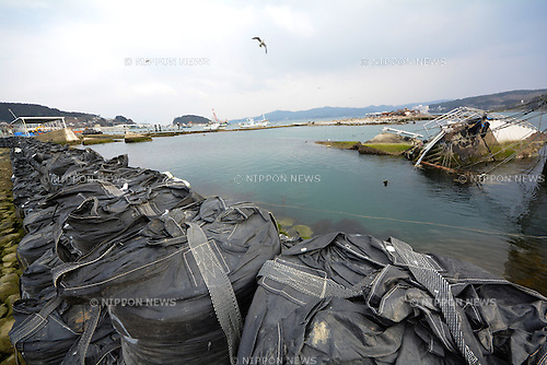 March 8, 2013, Minami-Sanriku, Japan - A part of a sunken ship is visible above the water in the port of this seaside village of Rikuzen-Tokura, Miyagi Prefecture on March 8. The community located deep inside an estuary by the Pacific Ocean was destroyed when the Magnitude 9.0 earthquake and ensuing mounds of tsunami struck the nation's northeast region, leaving more than 15,000 people dead and ravaging wide swaths of coastal towns and villages two years ago on March 11.  (Photo by Natsuki Sakai/AFLO).