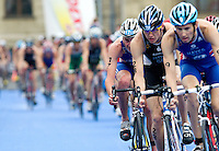 11 SEP 2010 - BUDAPEST, HUN - Alistair Brownlee (third from right) tucks in behind Maik Petzold of Germany at the start of another bike lap at the 2010 Elite Mens ITU World Championship Series Triathlon final (PHOTO (C) NIGEL FARROW)