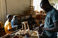UGANDA, Kampala, Kampiringisa, national rehabilitation center, a juvenile-detention facility for children and young people, vocational training, carpenter workshop  / Jugendhaftanstalt und Rehabilitationszentrum Kampiringisa, Berufsausbildung in Tischlerei Werkstatt