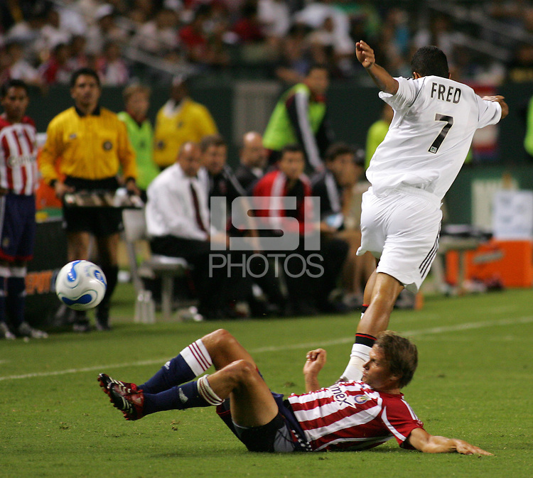 CD Chivas USA midfielder Jessie Marsch (15) slides for a loose ball as DC United midfielder Fred (7) leaps over him. CD Chivas USA tied D. C. United 2-2 during an MLS regular season match at the Home Depot Center, Carson, CA, on September 6, 2007.
